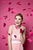 Beautiful young woman with hearts falling around — Stock Photo