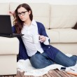 Young woman working from home - Stock Photo
