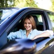 Young woman in her new car — Stock Photo