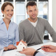 Young couple buying new home — Stock Photo #25733409