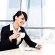 Businesswoman with tablet drinking coffee — Stock Photo #25735733