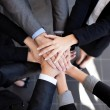 Business team joining hands — Stock Photo