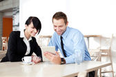 Two business with digital tablet — Stockfoto