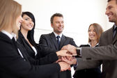 Happy Business team joining hands — Stock Photo