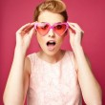Retro girl with heart sunglasses — Stock Photo #25781475