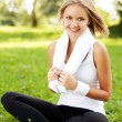 Happy young woman sitting on grass — Stock Photo #25783553