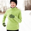 Happy woman running in winter — Stock Photo