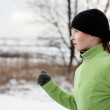 Woman running in winter — Stock Photo