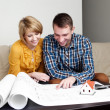 Stock Photo: Young couple watching home project