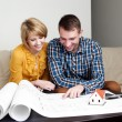 Young couple watching home project — Stock Photo