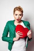 Woman hiding heart concept — Stock Photo