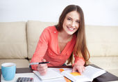 Happy female student learning — Stock Photo