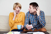 Shocked couple paying bills. — Stock Photo
