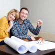 Couple with keys to new home — Stockfoto #25790757