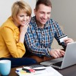 Stock Photo: Young couple online shopping