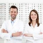 Team of happy opticians optometrists — Stock Photo