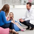 Stock Photo: Mother visiting optician, optometrist with child