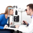 Stock Photo: Optometrist performing visual field test