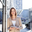 Beautiful businesswoman using digital tablet — Stock Photo