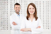 Team of happy opticians optometrists — Stock Photo
