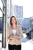 Beautiful businesswoman using digital tablet — Stock Photo