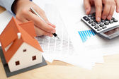 Counting payments for home — Stock Photo