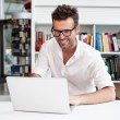 Happy man working with laptop — Stock Photo #29270435