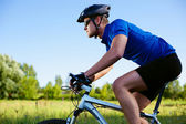 Mountain bike cyclist riding in country side — Stock Photo