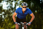 Happy Young man riding bicycle outside. Healthy Lifestyle. — Stock Photo