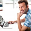 Stock Photo: Handsome happy mworking with laptop