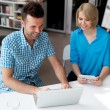 Designers working on laptop and digital tablet — Stock Photo
