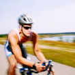 Triathlete cycling on a bicycle — Stock Photo #29355517