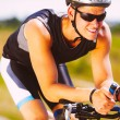 Triathlete cycling on a bicycle — Stock Photo #29355619