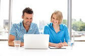 Happy business partners working on laptop — Stock Photo
