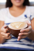 Woman holding cappucino caffee. Close-up. — Stock Photo