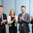 Happy business people clapping their hands — Stock Photo