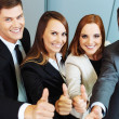 Business people showing thumbs up — Stock Photo