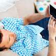 Man with digital tablet on the sofa — Stock Photo #33036937