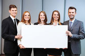 Business people holding billboard — Stock Photo