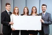 Business people holding billboard — Stock Photo