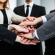 Stock Photo: Business people joining hands