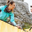 Stock Photo: Couple assembling tent