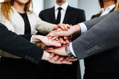 Business people joining hands — Stock Photo