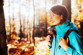 Young woman with backpack hiking — Stock Photo