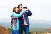 Hikers with binoculars — Stock Photo