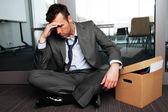 Sad fired businessman — Stock Photo