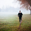 Running during foggy weather — Stock Photo