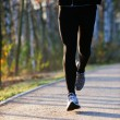 Closeup of runners legs — Stockfoto