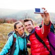 Young couple taking self picture — Stockfoto