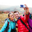 Young couple taking self picture — Stock Photo